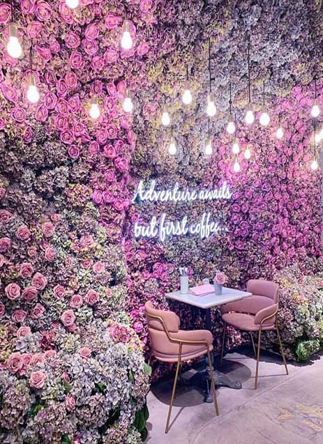 The iconic flower wall inside Elan Cafe London