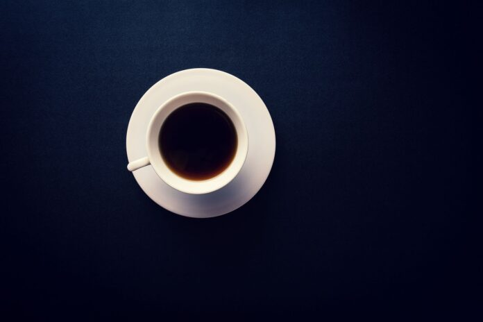 Black coffee with black background