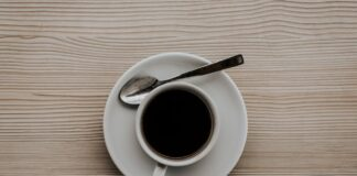 a cup of black coffee drink on the table
