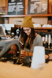 a barista smiling