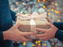 a person giving a gift